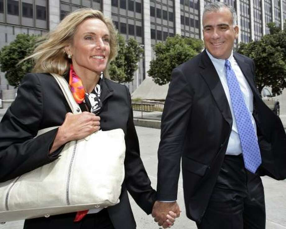 Former Brocade Communications Systems Gregory Reyes and wife Penny leave the federal building in San Francisco in July. Reyes was convicted Tuesday of defrauding investors. Photo: PAUL SAKUMA, ASSOCIATED PRESS FILE