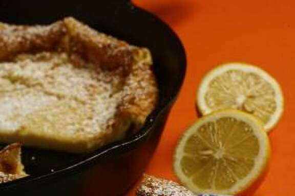 OUT OF THE FRYING PAN:  A golden pancake — fresh from the oven — is cut into wedges before serving.