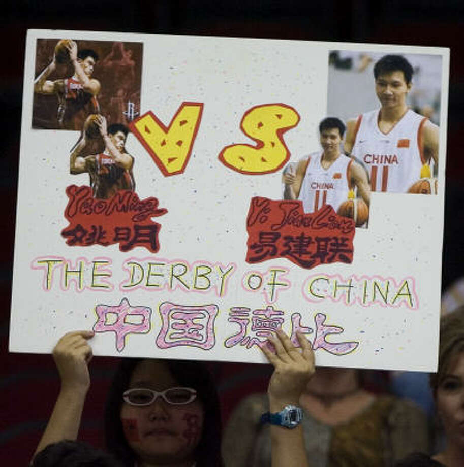 This fan knows how big of a deal Friday's game was. Tens of millions of Chinese viewers would have to agree. Photo: Smiley N. Pool, Chronicle
