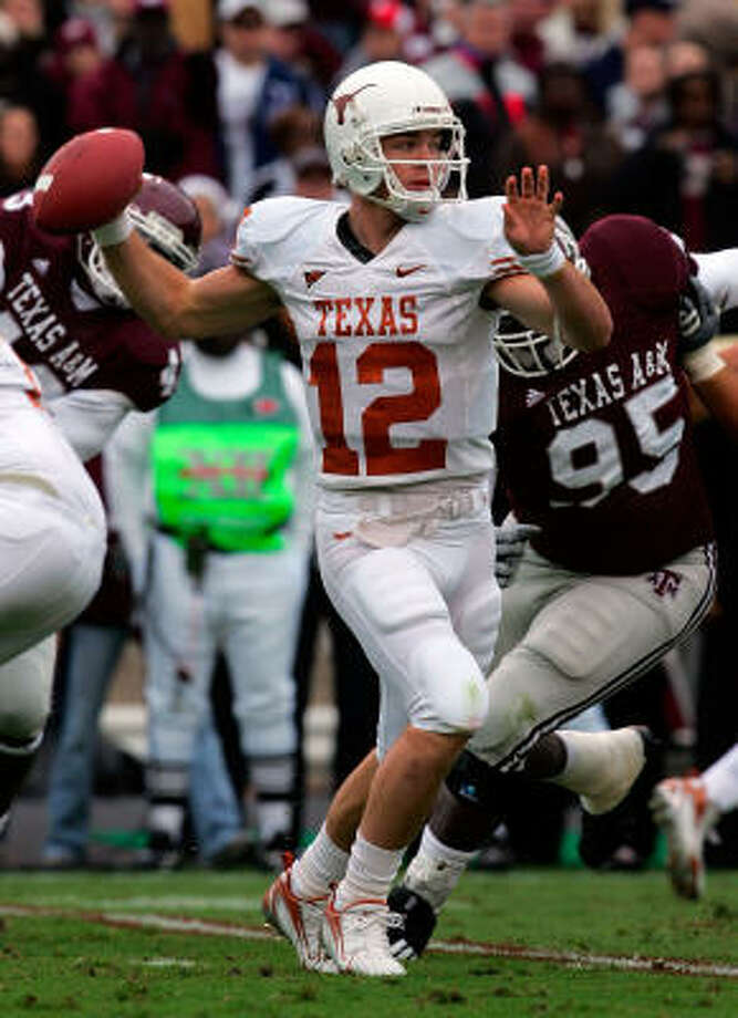 Texas quarterback Colt McCoy drops back to pass against Texas A&M in the first quarter at Kyle Field. Photo: Ronald Martinez, Getty Images