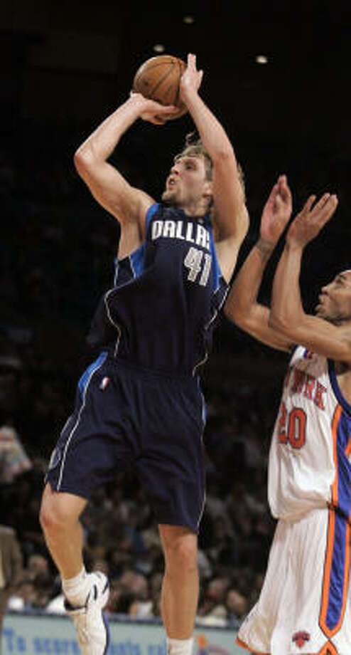 Mavericks forward (41) shoots in front of the Knicks' Jared Jeffries during the third quarter Monday. Nowitzki scored a season-high 36 points. Photo: Ed Betz, AP