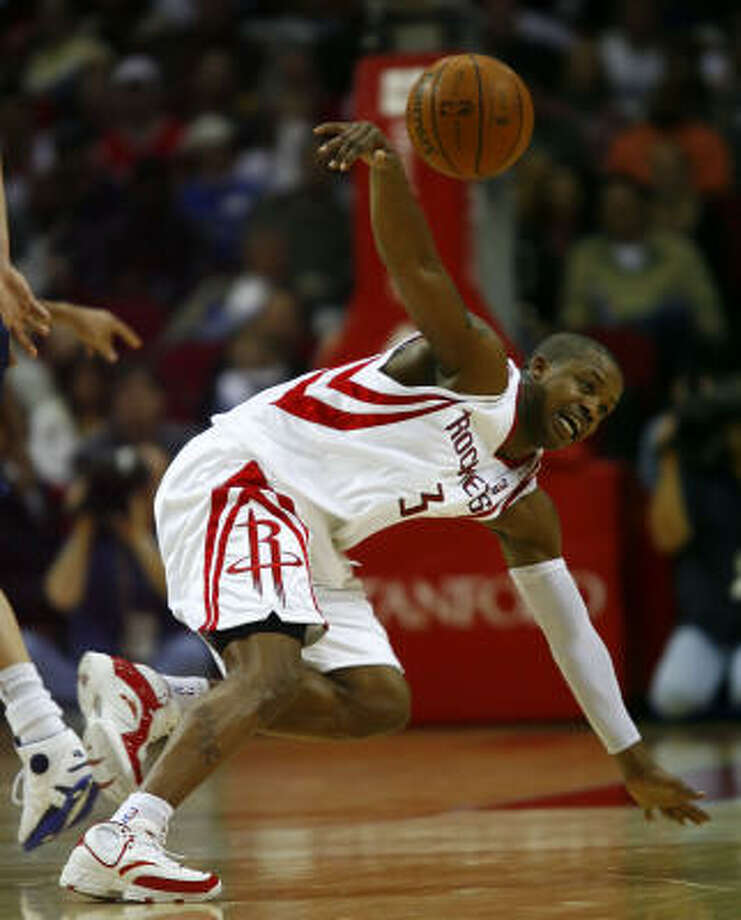 Rockets guard Steve Francis loses the ball after tripping. Francis scored three points on 1-of-8 shooting in 23 minutes for Houston. Photo: Steve Ueckert, Chronicle