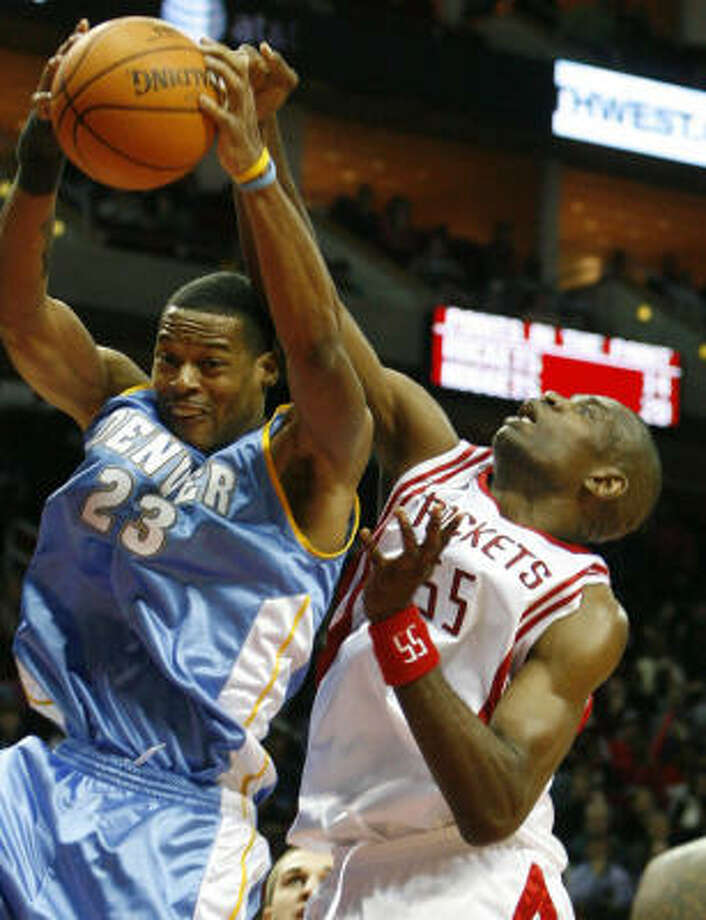 Dikembe Mutombo (55) topped double-digit rebounds again on Saturday. Photo: Billy Smith II, CHRONICLE