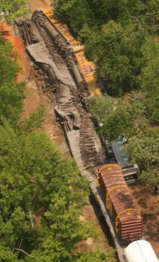 This freight train derailed near Demopolis, Ala., on Wednesday. The train, carrying segments of the space shuttle's solid rocket boosters, derailed after a bridge collapsed, authorities said. Photo: Michael E. Palmer, AP