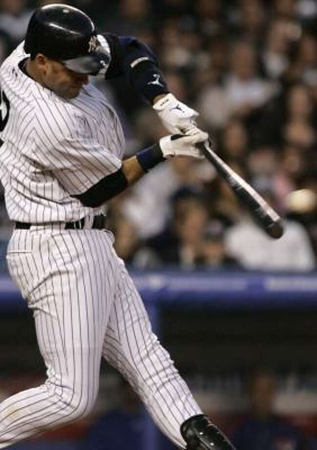 Derek Jeter connects on an RBI double that helped the Yankees beat the Rangers for the fourth time in four tries this season. Photo: JULIE JACOBSON, AP