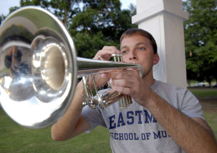 Drew Mitchell plays his trumpet. Photo: Kim Christensen, For The Chronicle