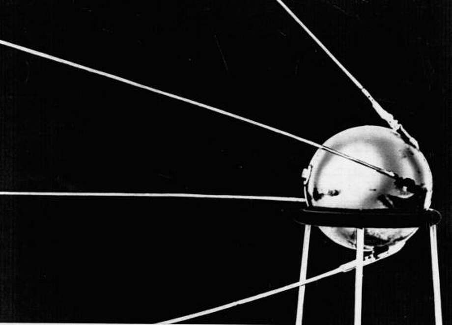 """On Oct. 4, 1957, Russia launched the first man-made satellite, called """"Sputnik."""" It is seen here mounted on a stand, in one of the first official photos released. Photo: UPI, Chronicle File"""