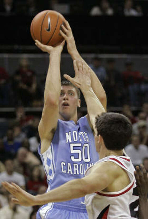 North Carolina's Tyler Hansbrough shoots over Davidson's Stephen Rossiter in Charlotte, N.C., Wednesday night. Photo: Chuck Burton, AP