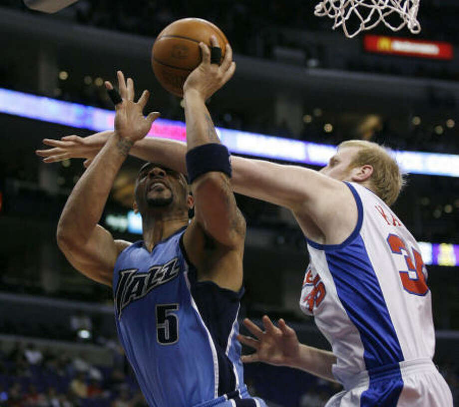 Yao Ming's task on Wednesday will be matching up against Clippers center Chris Kaman, right. Photo: Gus Ruelas, AP