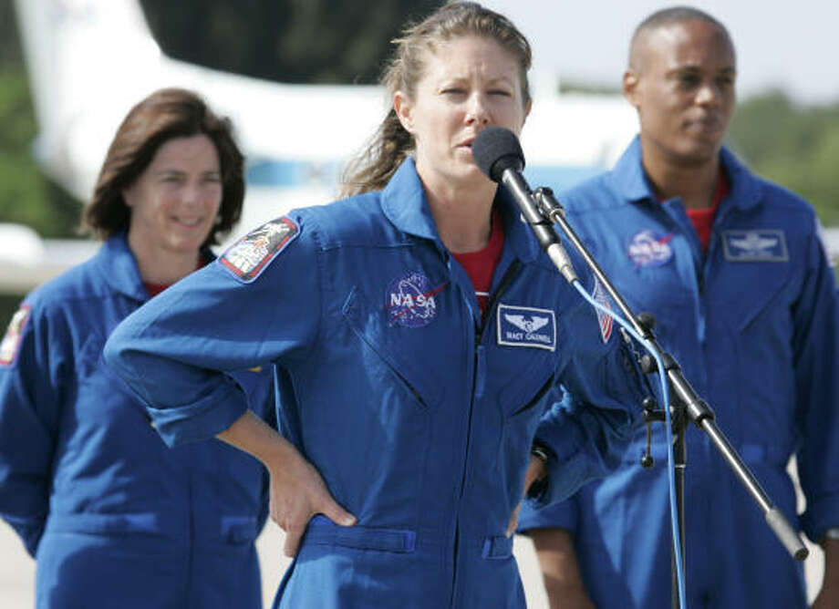 Space shuttle Endeavour mission specialist Tracy Caldwell talks to the media as teacher-turned-astronaut Barbara Morgan, left, and Alvin Drew Jr. look on after arriving at the Kennedy Space Center last week. Endeavour is scheduled for launch on Wednesday. Photo: Terry Renna, AP
