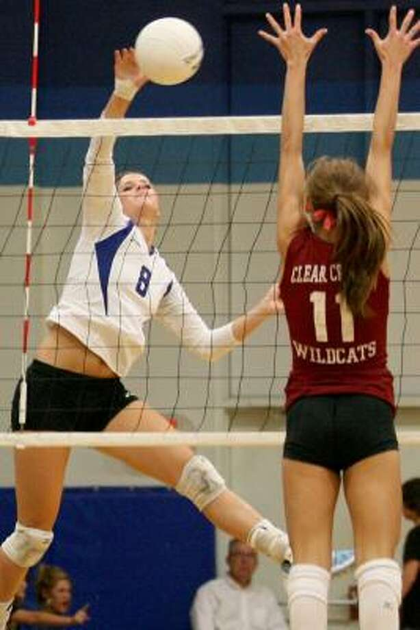 Christie Dorch makes one of her eight kills during Friendswood's win over Clear Creek. Photo: THOMAS B. SHEA, FOR THE CHRONICLE