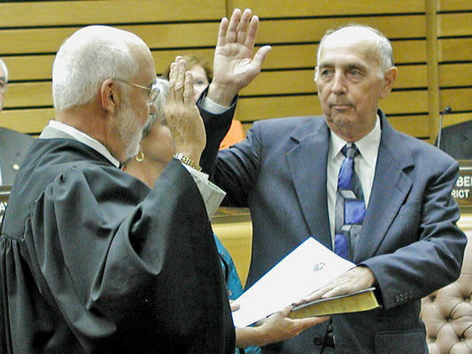 Municipal Judge Lester Rorick administers the oath of office to Jack Douglass, the interim mayor of Pasadena. Mayor John Manlove resigned Monday to run for Congress. Photo: Courtesy Of Wayne Holt