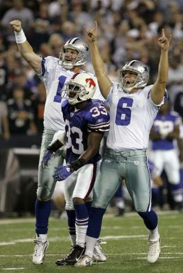 The Cowboys' Nick Folk (6) celebrates his game-winning field goal as the team improves to 5-0 in one of the most bizarre games in recent history. Photo: David Duprey, AP