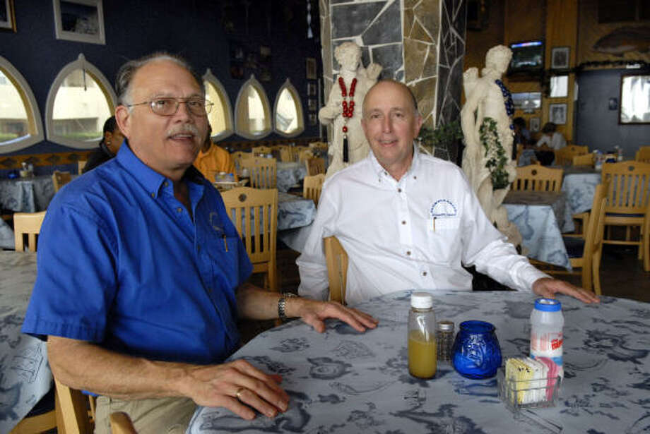 Larry Kriticos, right, and his brother Tikie sit at one of the tables in the Olympia Grill in Galveston. Photo: Kim Christensen, For The Chronicle