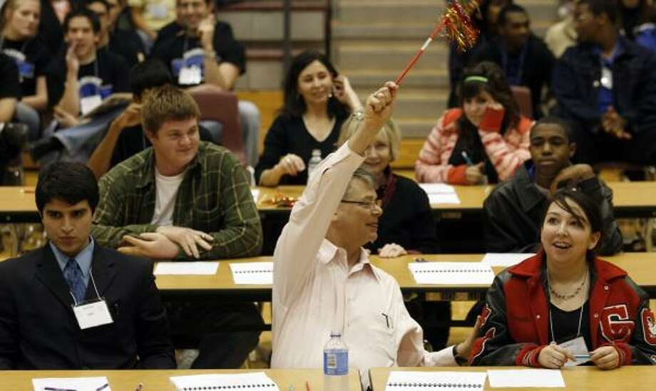 Marie Rosas, right, of Clear Brook High School, scores a point Saturday during the Super Quiz Academic Decathlon after Luis Baez, left, of Dobie High School, missed the question. More than 20 schools were represented at the event, which featured climate questions. Photo: JOHNNY HANSON, FOR THE CHRONICLE
