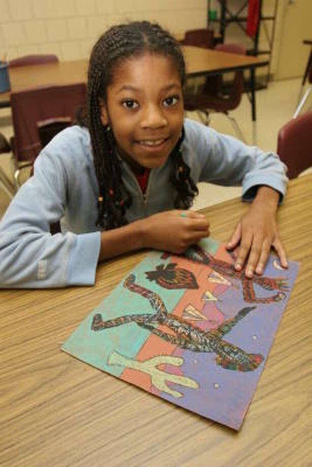 Erica Onuh, 9, fourth-grader at Stafford Elementary School, won Best of Show at the elementary level in the Stafford Municipal School District for her rodeo art mixed-media of dancing Indians near a pond. Photo: Suzanne Rehak, For The Chronicle