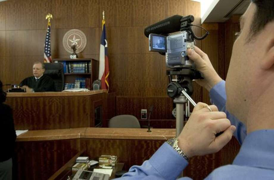 """Ethics rules don't allow judges to use courtrooms to """"audition,"""" but it's OK to tape proceedings. Harris County criminal court judge Sherman Ross was in the spotlight Friday. Photo: BRETT COOMER, CHRONICLE"""