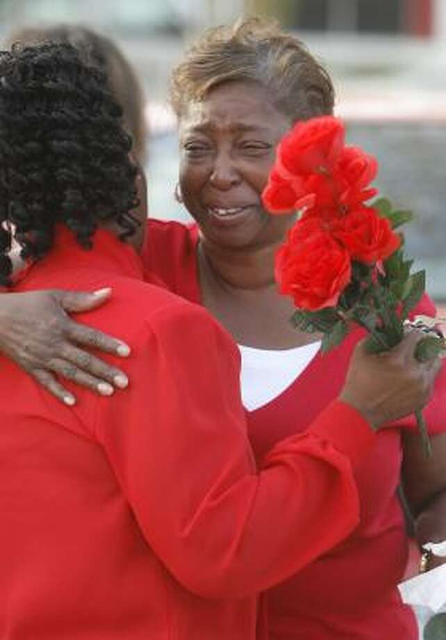 Gale Shields, the mother of Tynesha Stewart, is consoled by Yvonne Moore at a candlelight vigil for the Texas A&M student on Thursday. Sheriff's officials met with Shields before the vigil to inform her there would be no search for her daughter's body. Photo: Carlos Antonio Rios, Chronicle