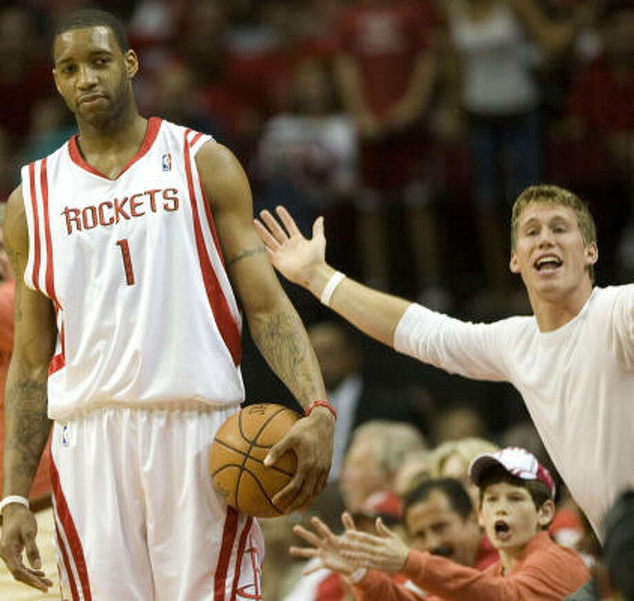 Tracy McGrady and the Rockets should start going over 100 points more often under Rick Adelman. Photo: Smiley N. Pool, Chronicle