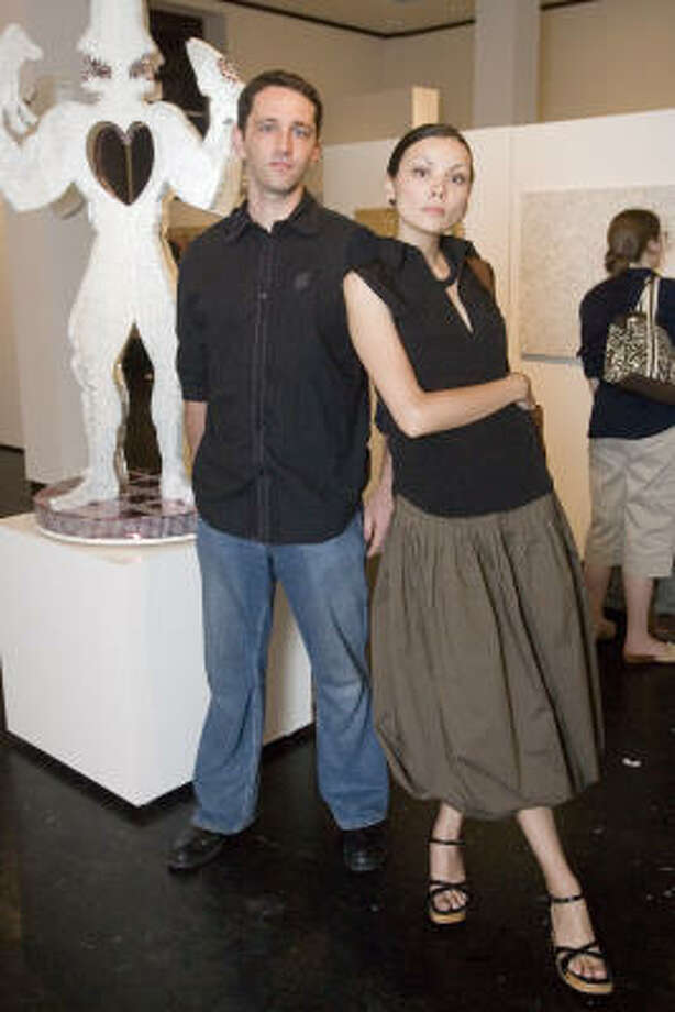 Travis Ellinger and Anna Ataeva toured the exhibit, which is on display through Aug. 18. Photo: Bill Olive, For The Chronicle