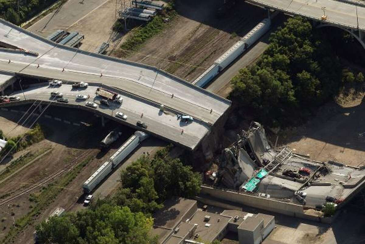Vehicles rest on a collapsed section of the I-35W bridge in Minneapolis.