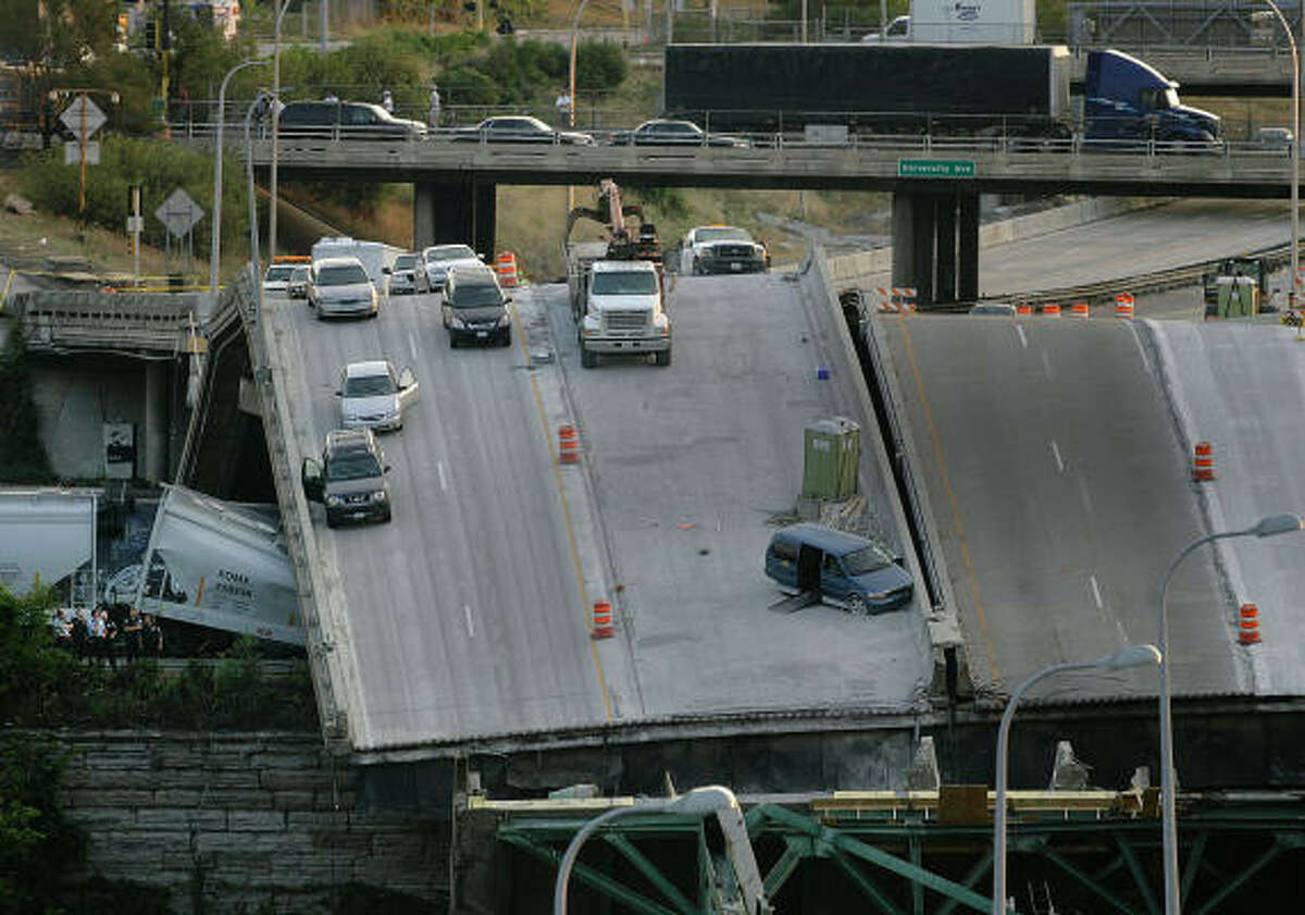Vehicles sit atop the Interstate 35W bridge over the Mississippi River in Minneapolis.