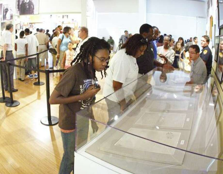 Kaamilah Furqah, 13, views the Emancipation Proclamation on Saturday at the William J. Clinton Presidential Library in Little Rock. Photo: Brian E. Chilson, Associated Press