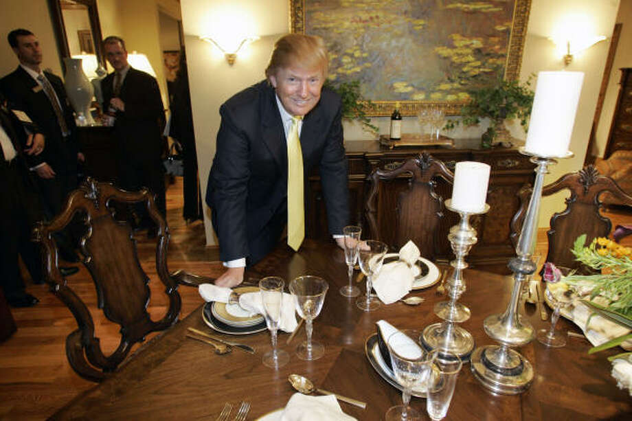 Real-estate tycoon Donald Trump poses with a dining room suite during the introduction of his new furniture line by Thomasville Furniture in Thomasville, N.C. Photo: Chuck Burton, Associated Press