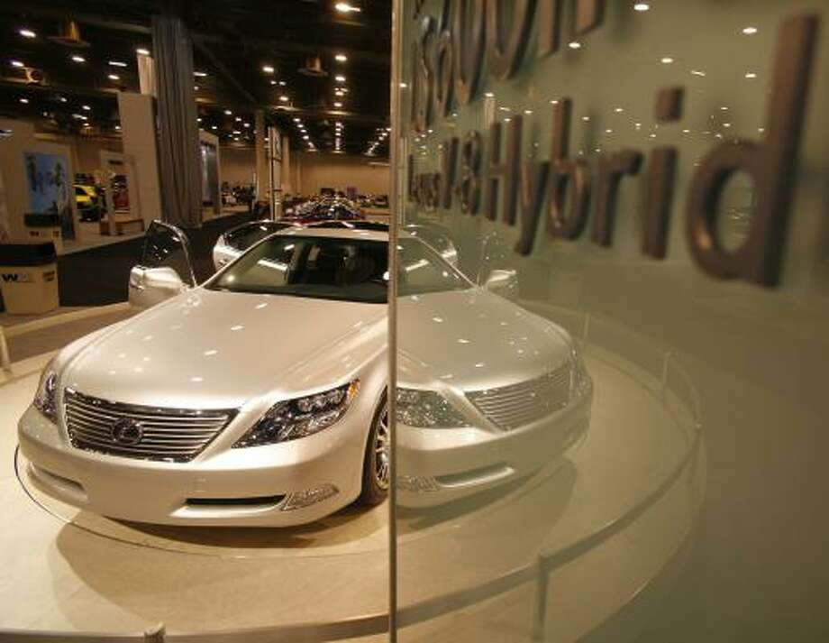 A Lexus LS 600 HL hybrid sedan awaits admirers at the 2007 Houston auto show in January. Toyota's luxury brand tripled its sales between 1997 and 2006 while U.S. luxury brands faded. Photo: STEVE UECKERT, CHRONICLE FILE