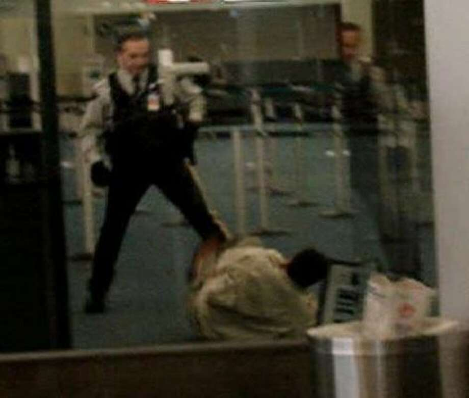Robert Dziekanski, 40, falls to the floor of the Vancouver airport after being hit by a police Taser, in this image from a video. Photo: THE CANADIAN PRESS PHOTOS