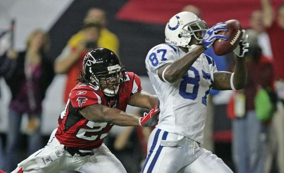 Atlanta's Chris Houston, left, is too late in coverage to stop Colts receiver Reggie Wayne from scoring on a Peyton Manning pass in the second quarter. Photo: JOHN BAZEMORE, ASSOCIATED PRESS