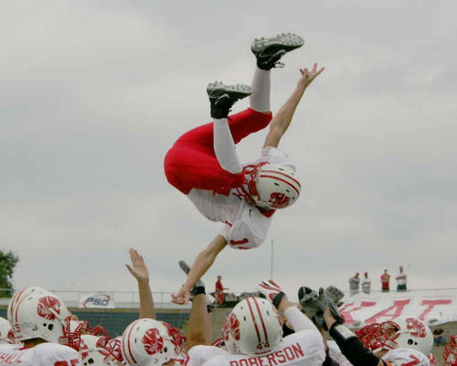 Katy's Jonathan Gil went airborne after the last playoff win. Photo: Margaret Bowles, For The Chronicle