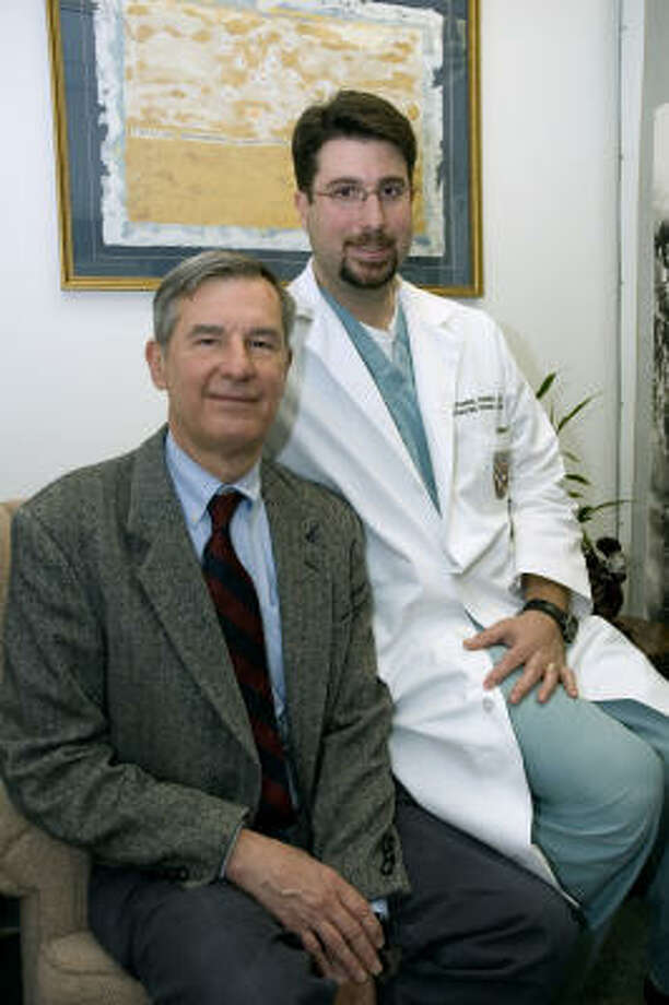 From left, Drs. Henry and Nathaniel Strobel are conducting research into stopping an inflammation process seen in head injury patients at the University of Texas Medical School at Houston. Photo: Courtesy Of UT Medical School