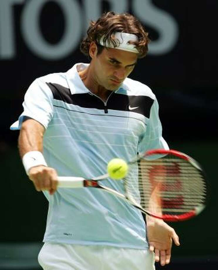 Roger Federer of Switzerland places a masterful forehand shot during his first-round match against Bjorn Phau of Germany on day one of the Australian Open 2007. Photo: Cameron Spencer, Getty Images