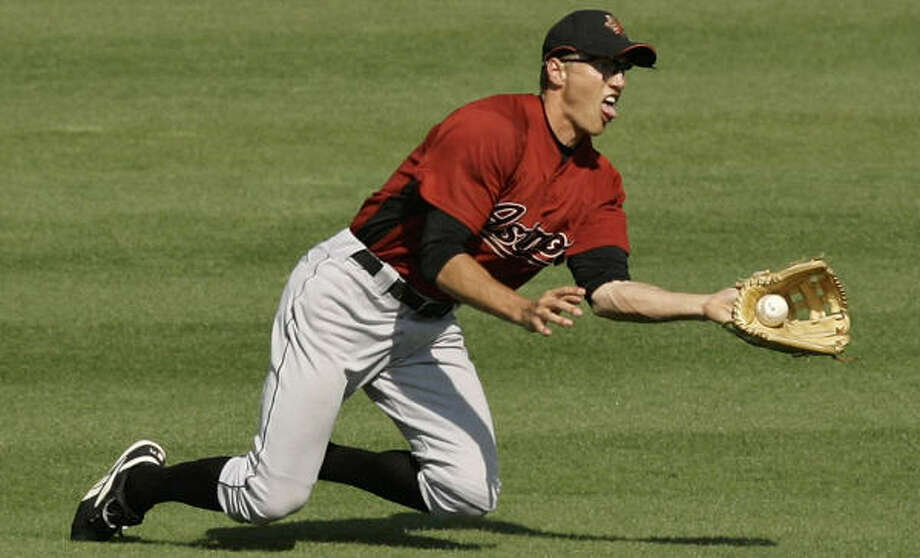 With Jason Lane and Luke Scott competing for the Astros' right-field starting job, Hunter Pence will start the season at Class AAA Round Rock. Photo: Kathy Willens, AP