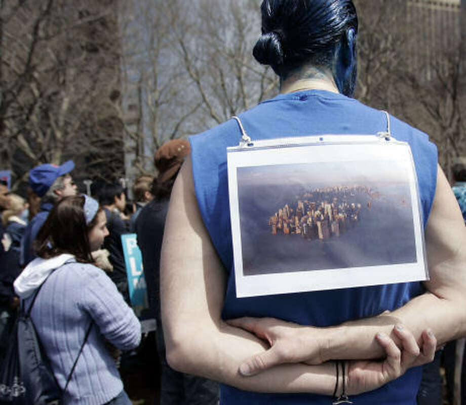 A blue painted man wearing a computer generated images of Manhattan Island flooded participates in an environmental rally on Saturday in New York City. Photo: Stephen Chernin, Getty Images