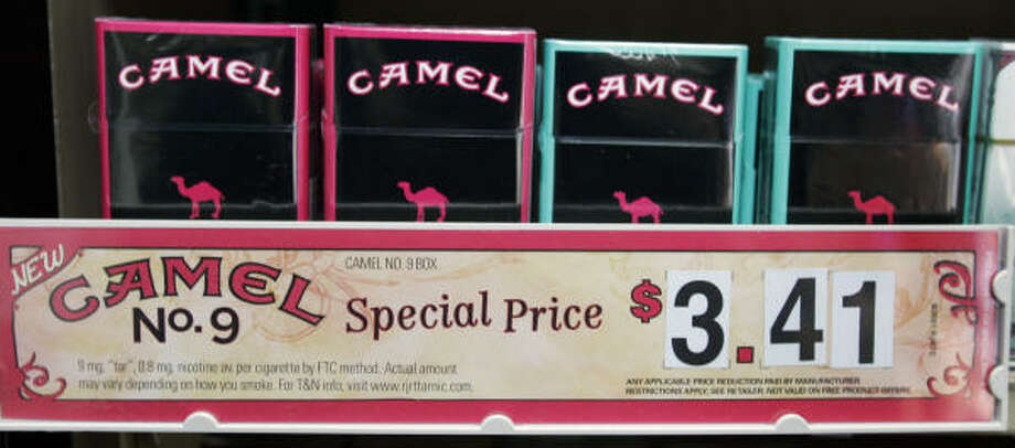 "Packages of Camel cigarettes are shown at a store in Charlotte, N.C. With the slogan ""Light and Luscious,"" the R.J. Reynolds Tobacco company launched Camel No. 9. with a campaign squarely aimed at women. Photo: Chuck Burton, AP"