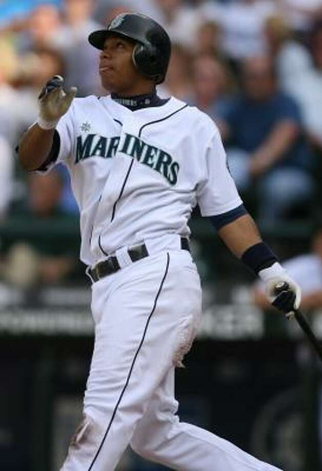 Jose Lopez came through for the Mariners on Wednesday, driving in Ichiro Suzuki with a double in the 11th inning. Photo: OTTO GREULE JR., GETTY IMAGES