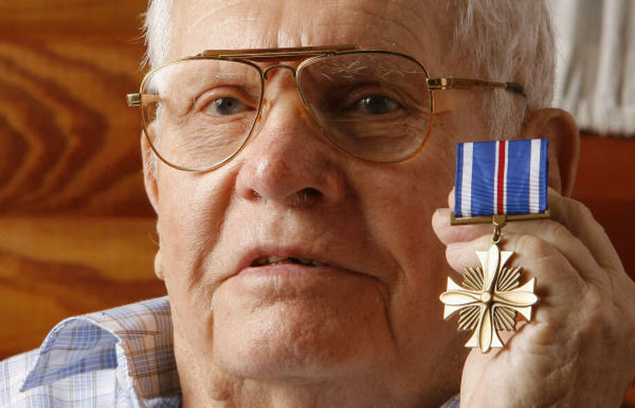 After waiting for decades, Robert Morris ``Buster'' Bricker Jr. earlier this year finally received the award he earned for surviving 50 combat missions during World War II. Bricker died Saturday after congestive heart and kidney failure. Photo: Steve Campbell, Houston Chronicle