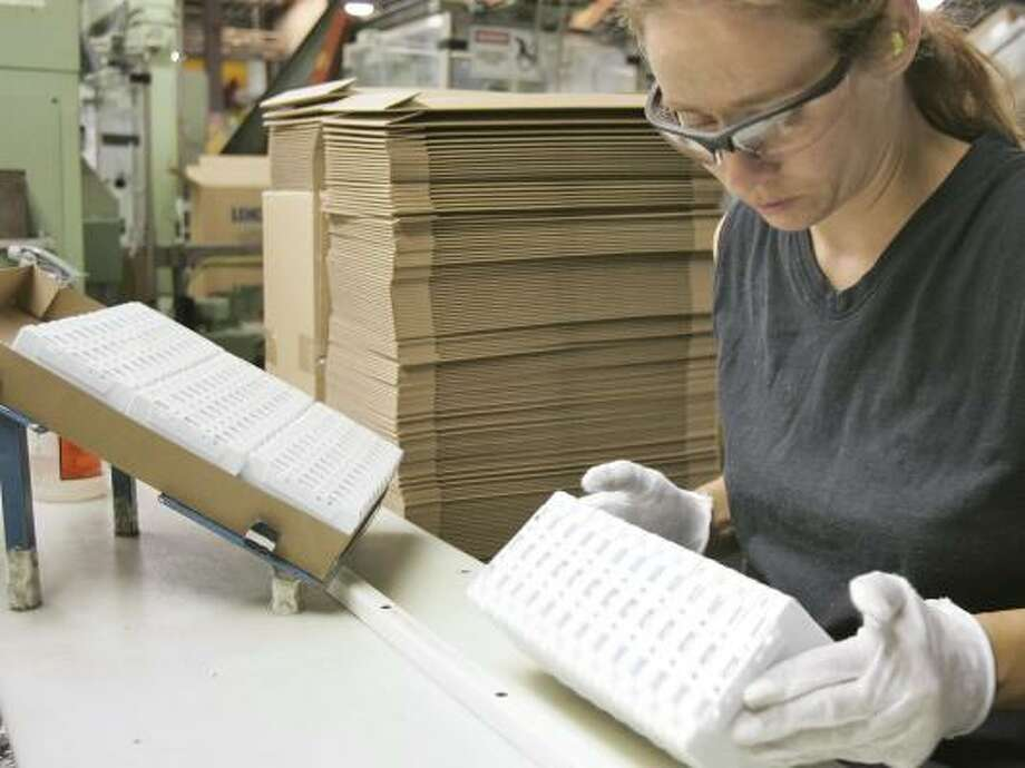 Cassettes are inspected for quality at Lenco-PMC, the last makers of cassette tapes in North America. There is sufficient demand for the production of 22 million cassettes a year. Photo: NATI HARNIK, ASSOCIATED PRESS