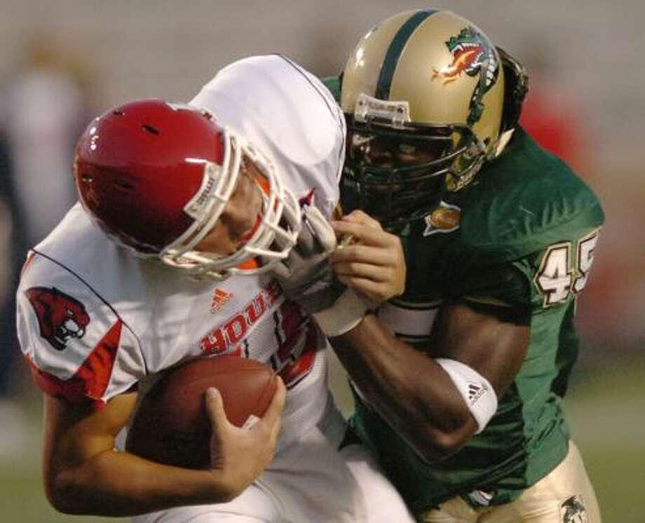 UAB's B.J. Steed sacks Houston quarterback Blake Joseph. Photo: Hal Yeager, AP