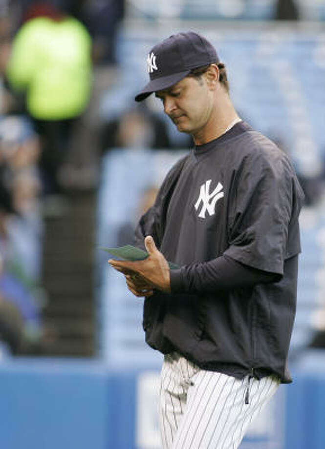 Don Mattingly would like to make out the Yankees' lineup card rather than the occasional duty of delivering it as he did while the team's bench coach. Photo: Ed Betz, AP