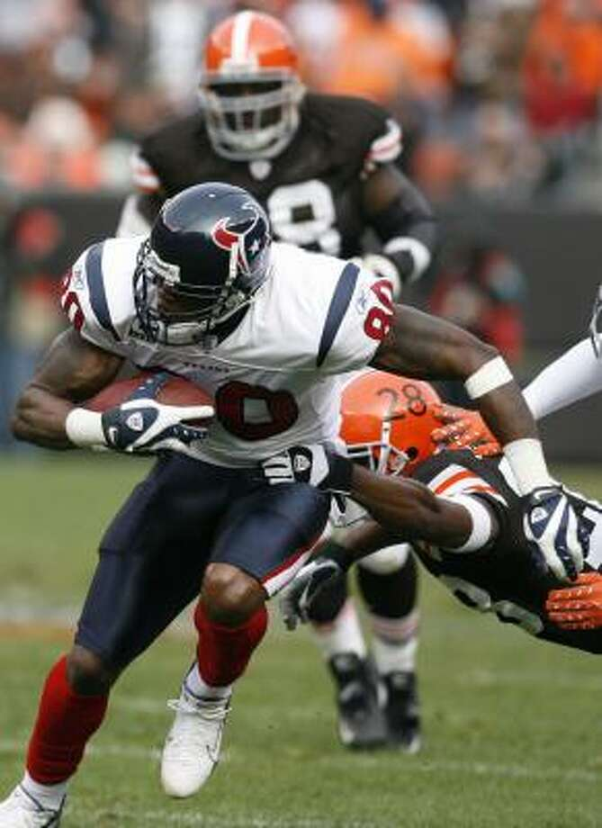 Andre Johnson, left photo, was surrounded by Browns defenders most of the day and had only three catches for 37 yards. Owen Daniels, right, did find the end zone, but he also lost a critical fumble and took a vicious hit from Cleveland's Brodney Pool (21). Photo: Billy Smith II, Chronicle