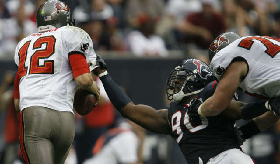 The Bucs resort to holding to stop Mario Williams. Photo: Kevin Fujii, Chronicle