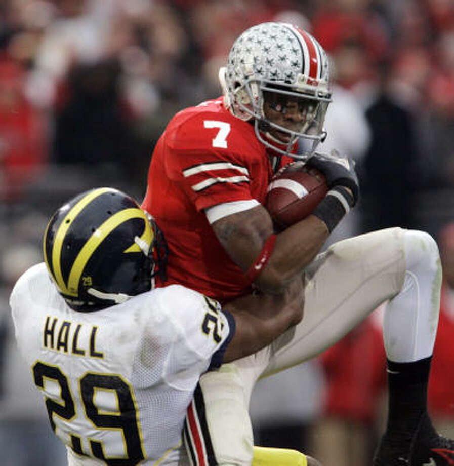 Ted Ginn Jr. helps Ohio State to its second victory over a No. 2 team this season by catching a touchdown pass against Michigan cornerback Leon Hall during the Buckeyes' 42-39 win in November. Ohio State beat then-No. 2 Texas in September and plays Florida, the current second-ranked team, for the national title on Monday. Photo: AMY SANCETTA, AP
