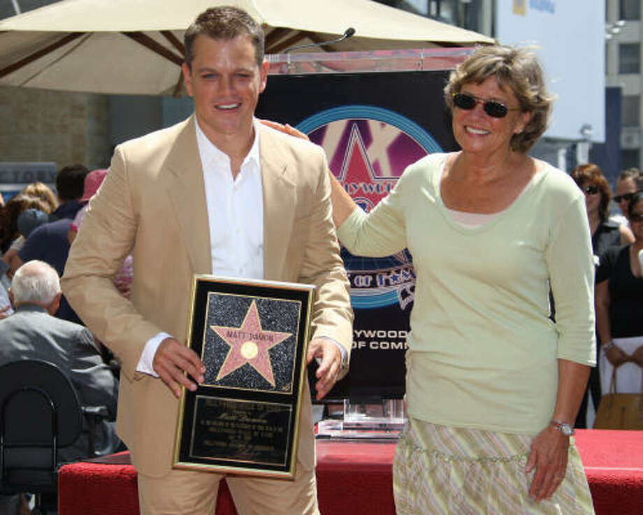 Actor Matt Damon smiles after getting a kiss from his mother Nancy Carlsson-Paige at a ceremony Wednesday at which the actor was honored with a star on the Hollywood Walk of Fame. Photo: ROBYN BECK, AFP/Getty Images