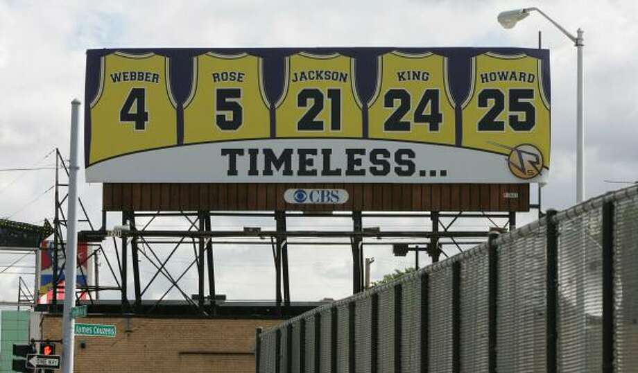 "Michigan's Fab Five jerseys are represented on a billboard in Detroit. Jalen Rose is honoring his teammates because, ""We have no banners and representation"" at Michigan. Photo: PATRICIA BECK, DETROIT FREE PRESS"