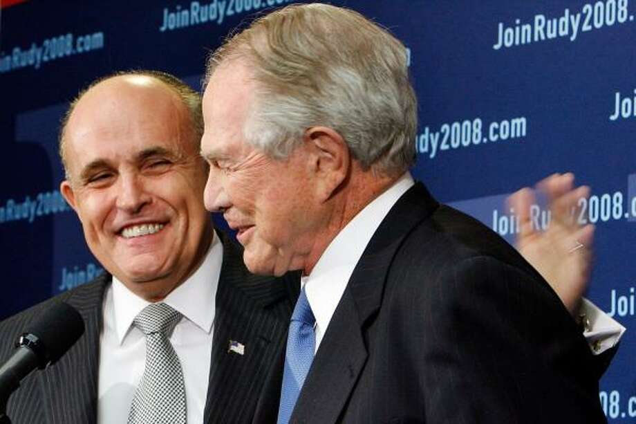 Former New York Mayor Rudy Giuliani has a pat for conservative evangelical leader Pat Robertson after he endorsed Giuliani, partly because Giuliani would nominate conservative high court judges. Photo: CHIP SOMODEVILLA, GETTY IMAGES