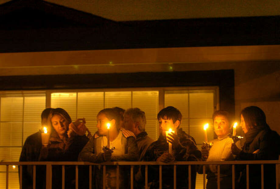 Mourners gather to remember Carlos Sousa Jr. during a candlelight vigil in San Jose, Calif., on Saturday. Photo: Noah Berger, Associated Press
