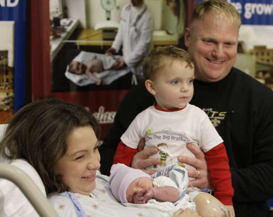 Rebekah Markham, holding Noah, celebrates with her husband, Glen, and son Witt at St. Tammany Parish Hospital on Tuesday. Photo: Alex Brandon, AP
